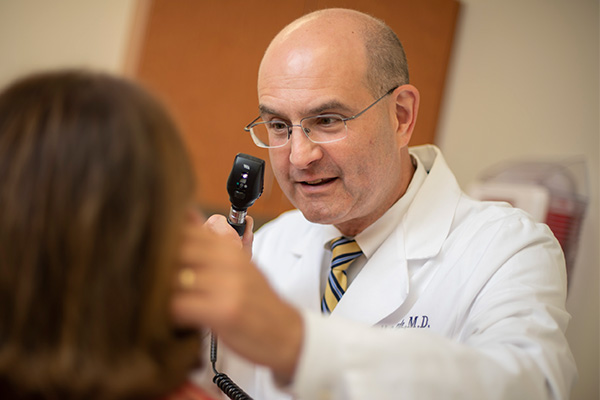 Dr. Russell Zide during an examination.